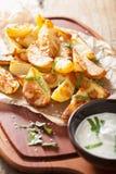 Baked potato wedges with yogurt dip Stock Photography