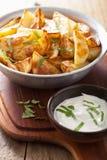 Baked potato wedges with yogurt dip Royalty Free Stock Images