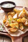 Baked potato wedges with yogurt dip Stock Image