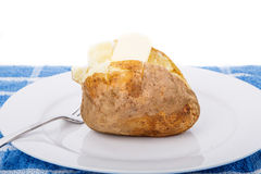 Baked Potato on White Plate and Blue Towel with Butter Royalty Free Stock Photo