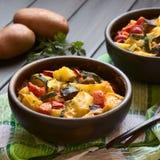 Baked Potato, Zucchini, Eggplant and Tomato Casserole Stock Photos