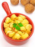 Baked potatoes. Delicious baked potatoes in ceramic pot Stock Photos