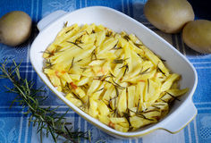 Baked potatoes. Tray of sliced potatoes cooked in the oven Royalty Free Stock Photos