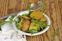 Baked potatoes with arugula and lemon zest Royalty Free Stock Photography