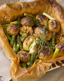 Baked potatoes with asparagus and garlic Royalty Free Stock Photography