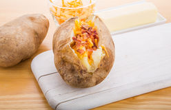 Baked Potatoes with Bacon and Cheese Royalty Free Stock Images
