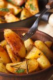 Baked potatoes in a bowl macro on the table. vertical Royalty Free Stock Images