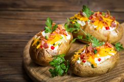 Baked potatoes with cheese and bacon Stock Image