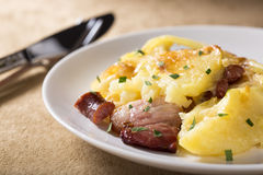 Baked potatoes with cheese Stock Photos