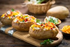 Baked potatoes with cheese and bacon Royalty Free Stock Images
