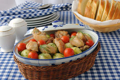 Baked potatoes with chicken and tomato Stock Images