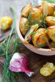 Baked potatoes, dill and garlic. Royalty Free Stock Photo