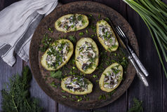 Baked potatoes filled with fresh mushrooms stock photography