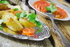 Baked potatoes, fresh vegetables and fish fillets Royalty Free Stock Images
