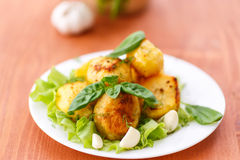 Baked potatoes with garlic Stock Images