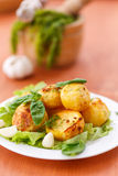 Baked potatoes with garlic Royalty Free Stock Photo