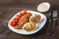 Baked potatoes with grilled chicken Stock Photography