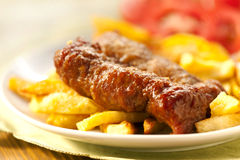 Baked potatoes and grilled meat Stock Photo