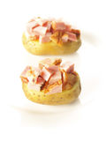 Baked potatoes with ham Stock Photography