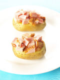Baked potatoes with ham Royalty Free Stock Images