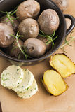 Baked potatoes with herbs butter Royalty Free Stock Image