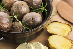 Baked potatoes with herbs butter Royalty Free Stock Photos