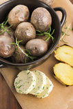 Baked potatoes with herbs butter Royalty Free Stock Images