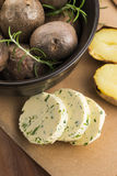 Baked potatoes with herbs butter Stock Photos