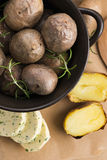 Baked potatoes with herbs butter Stock Photo