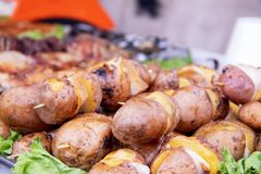 Baked roasted potatoes with lard, spices and salt royalty free stock image