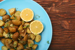 Baked potatoes with lemon Stock Photos