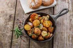 Baked potatoes in a pan Stock Photos