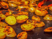 Baked potatoes on the peasant stove Stock Images