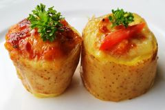 Baked Potatoes With Pizza stock photography