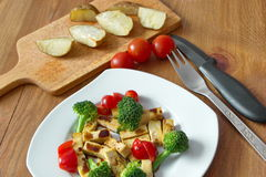 Baked potatoes with plate of vegetable served on the wooden table Stock Photography