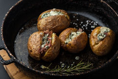 Baked potatoes with prosciutto and chees Royalty Free Stock Photo
