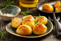 Baked potatoes with rosemary Stock Photography