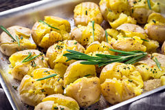Baked potatoes with rosemary, garlic and pepper Stock Image