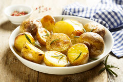 Baked potatoes. With rosemary and rose pepper Royalty Free Stock Photo