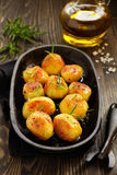 Baked potatoes with rosemary. Stock Images