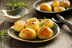 Baked potatoes with rosemary. Royalty Free Stock Photography