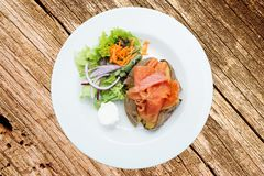 Baked potatoes with salmon stock photo