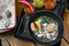 Baked potatoes in salt with hot salsa stock photo