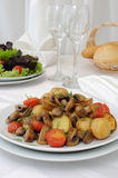 Baked potatoes with slices of mushrooms and tomatoes Stock Photography