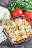 Baked potatoes with sour cream sauce, vegetables and herbs, spic Stock Photography