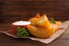 Baked potatoes with spices and sour cream Royalty Free Stock Image