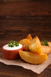 Baked potatoes with spices and sour cream Stock Images