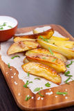 Baked potatoes with spices. Vertical Stock Photos