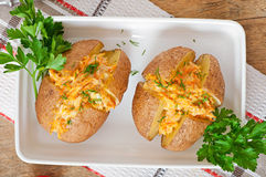 Baked potatoes stuffed with minced chicken and carrots Stock Photo