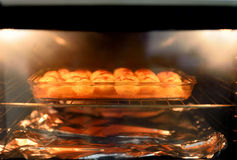 Baked potatoes in oven. Baked tasty potatoes in oven Royalty Free Stock Photos